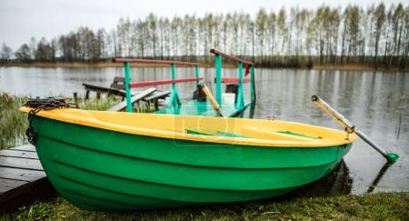 Classic boat with oars on the river.