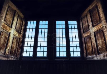 Open window in a dark room.