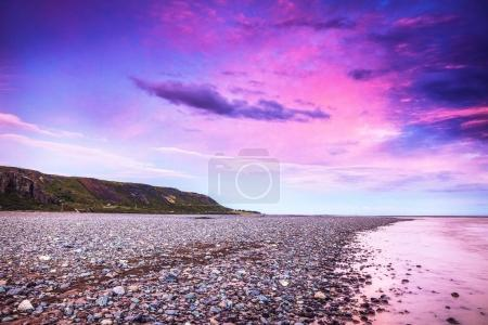 Photo for Picturesque landscape of a mountain river with traditional nature of Iceland at amazing sun set. - Royalty Free Image
