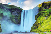 Picturesque landscape of a mountain waterfall and traditional na
