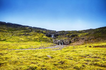 Photo for Picturesque landscape of a mountain waterfall and traditional nature of Iceland. - Royalty Free Image