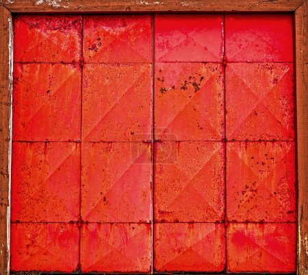Red metal background close-up.