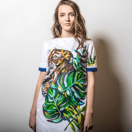 Beautiful young girl in a t-shirt pose in studio.
