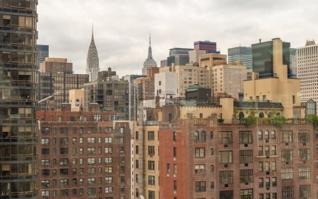 Photo for Aerial view of Manhattan buildings. Metropolis skyline. - Royalty Free Image