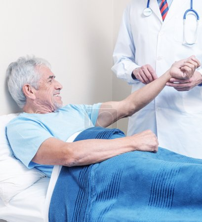 Doctor and patient. Measurement of blood pressure in a hospital