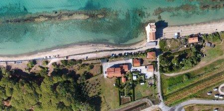 Overhead aerial view of sandy beach in Mediterranean Sea