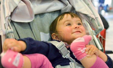Baby girl happy in the stroller