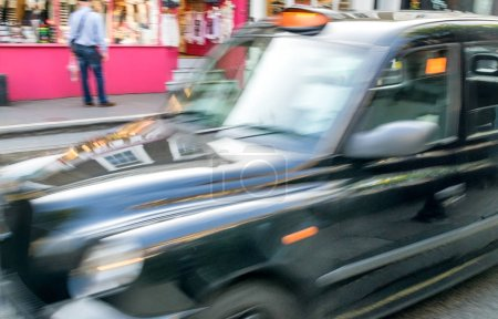 Fast moving blurred taxi in London