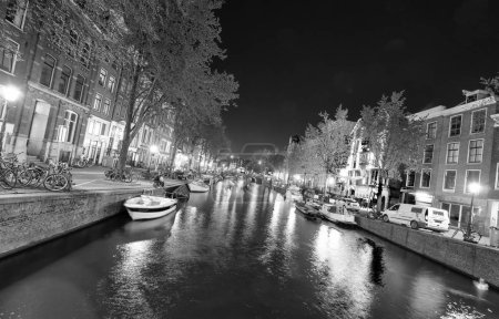 City canals at night for Queen's Day