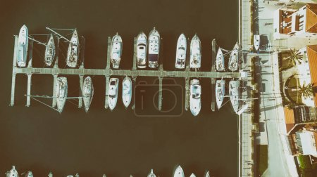 Overhead aerial view of anchored boats in a small port