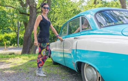 Woman entering colourful old car