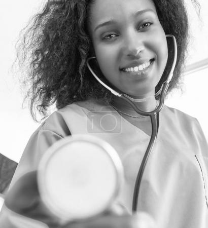 Confident african female doctor with stethoscope