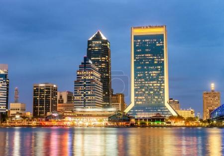 Jacksonville, Florida. City lights at night with river reflectio