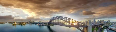 Sydney Harbour Bridge at sunset, panoramic view from the sky