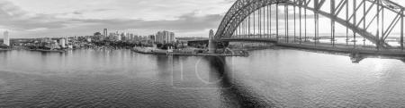 Black and white sunset aerial view of Sydney Harbour Bridge, NSW