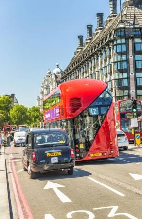 LONDON - MAY 2013: Red Double Decker bus along city streets. Lon