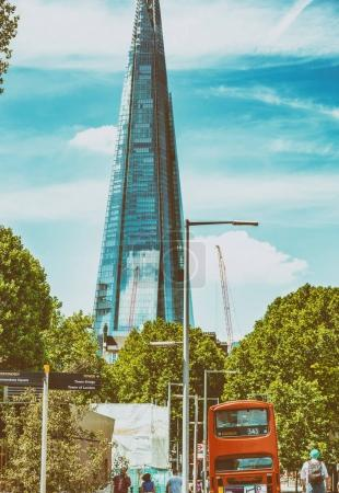 LONDON - JUNE 2013: Classic city red bus along city streets. Lon