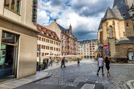LEIPZIG, GERMANY - JULY 17, 2016: Tourists visit city streets. Leipzig attracts 3 million tourists annually.
