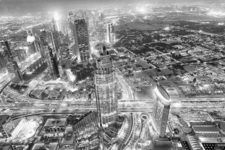 Aerial view of Downtown Dubai at night.
