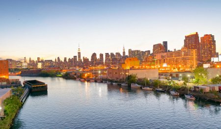 Midtown Manhattan and East River at sunset, New York City.
