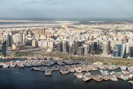 DUBAI, UAE - DECEMBER 9, 2016: Aerial view of Deira skyline from helicopter. The city attracts 30 million tourists annually.