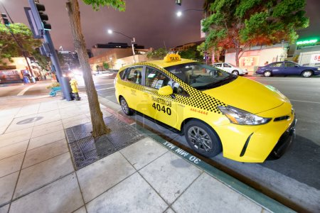 SAN DIEGO - JULY 30, 2017: Yellow cab awaits for customers. Th company promotes the service with low rates and fast service.