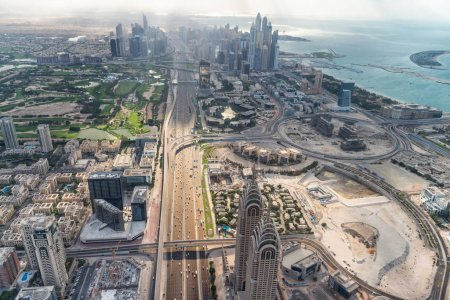 Aerial view of Downtown skyline along Zayed Road from helicopter. The city attracts 30 million tourists annually.