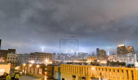 Midtown Manhattan skyline on a cloudy night, New York City.