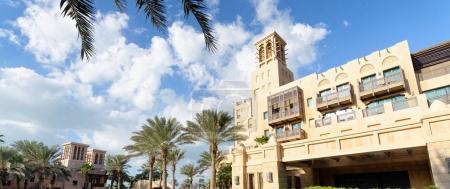 Dubai Madinat Jumeirah skyline on a sunny day.