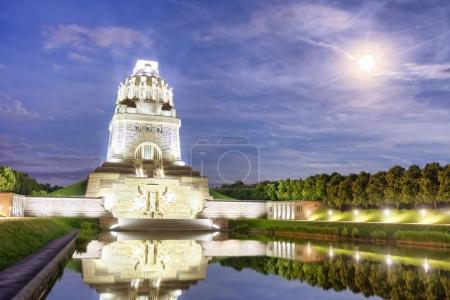 Battle of nations monument with Lake at night in Leipzig, Germany.