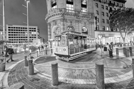 SAN FRANCISCO - AUGUST 7, 2017: Antique Cable Car on Powell Street Turntable as the car is turned around at night. It is a major city attraction.