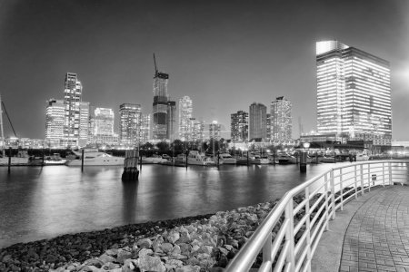 Downtown Manhattan at night as seen from Jersey City.