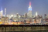"""Постер, картина, фотообои """"Нью-Йорк ночью. Аэрофотоснимок Манхэттен огней, США."""""""
