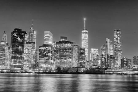 Night skyline of New York City in black and white, USA.