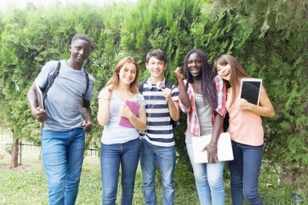 Multi ethnic teenagers smiling outdoor.