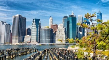 Manhattan skyline view from Brooklyn Bridge Park in autumn, New York City.