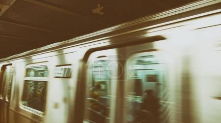 Subway train speeding up.