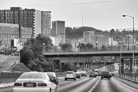 PORTLAND, OREGON - AUGUST 21, 2017: City traffic to the airport. Portland attracts 5 million people annually.