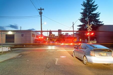 PORTLAND, OREGON - AUGUST 21, 2017: City traffic with fast moving train. Portland attracts 5 million people annually.