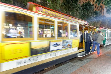 SAN FRANCISCO - AUGUST 7, 2017: Cable car at night along city streets. They are a famous tourist attraction.