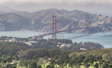 San Francisco Golden Gate Bridge and Sausalito mountain on background, aerial view from helicopter, California - USA.