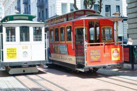 SAN FRANCISCO - AUGUST 6, 2017: Cable cars on a sunny day along city streets. They are a famous tourist attraction.