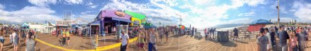 SANTA MONICA, CA - AUGUST 1, 2017: Tourists in Santa Monica Pier on a beautiful summer day. The pier contains Pacific Park, a family amusement park.