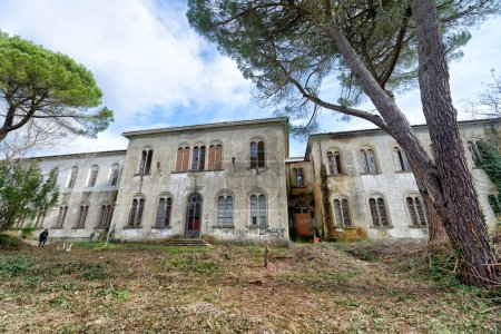 VOLTERRA, ITALY - FEBRUARY 24, 2018: Exterior view of Charcot building. It is part of the of abandoned asylum, closed in 1984