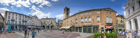 BERGAMO, ITALY - JULY 16, 2017: Tourists visit Bergamo Alta square, panoramic view. Bergamo is a major attraction in Italy.
