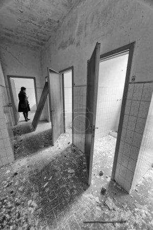 VOLTERRA, ITALY - FEBRUARY 24, 2018: Interior of abandoned asylum bathrooms. It closed in 1984.
