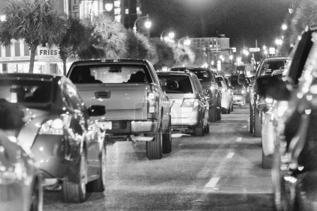 MYRTLE BEACH, SC - APRIL 4, 2018: City car traffic at night. The city is a famous tourist attraction.