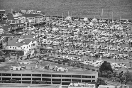 SAN FRANCISCO - AUGUST 7, 2017: San Francisco port aerial view with docked boats. The city hosts 20 million tourists.