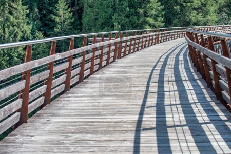 Wooden bridge in mountain scenario.