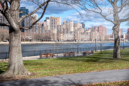 Photo for New York City Manhattan buildings from Queensbridge Park on a beutiful winter day. - Royalty Free Image